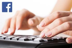 Woman hands writting on black computer keyboard